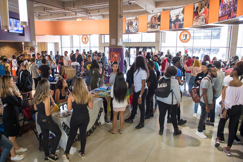 Student organizations talking with students in the Campbell Student Union lobby at Buffalo State College.