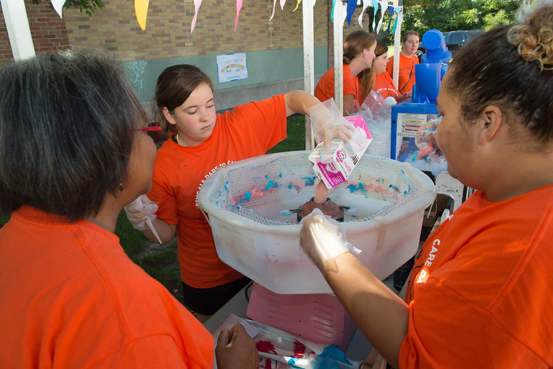 Students working at Buffalo Public School #30 block party during Bengals Dare to Care Day at Buffalo State College.