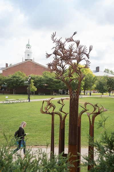 Student walking past Hank Mann sculpture at Buffalo State College.