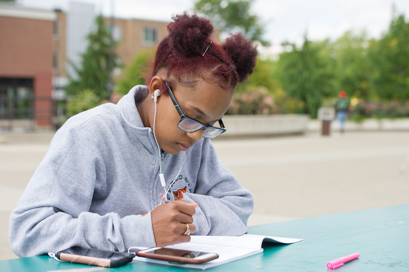 Student studying in Campbell Student Union quad at Buffalo State College.