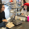 Student talking in retail dining area of Student Union at SUNY Buffalo State College.
