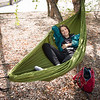 Student in hammock on campus at SUNY Buffalo State.