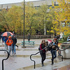 Students walking in Plaza on rainy day at SUNY Buffalo State College.