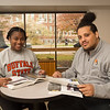 Students studying in Rockwell Hall back lobby at SUNY Buffalo State College.