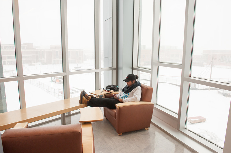 Student studying in SAMC (Science and Mathematics Complex) at Buffalo State College.