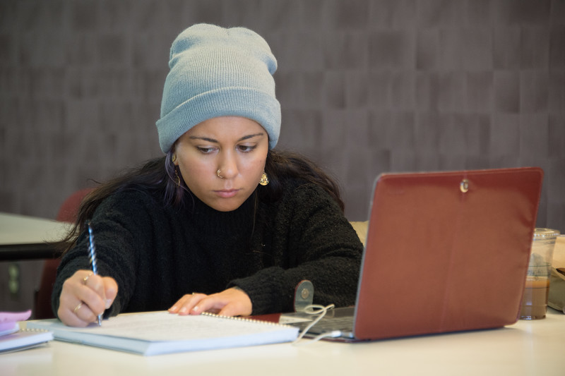 Student studying in Campbell Student Union at Buffalo State College.