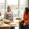 Creative Studies students talking in Science and Math Complex at Buffalo State College.