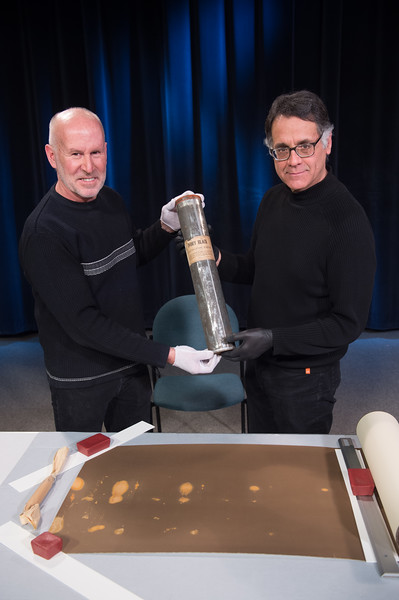 Video recording session with Art Conservation Director Patrick Ravines and photographer and collector Rob McElroy opening early 19th Century platinotype paper cannister at Buffalo State College.