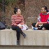 Spring campus scenic of students talking in the Union Quad at Buffalo State College.