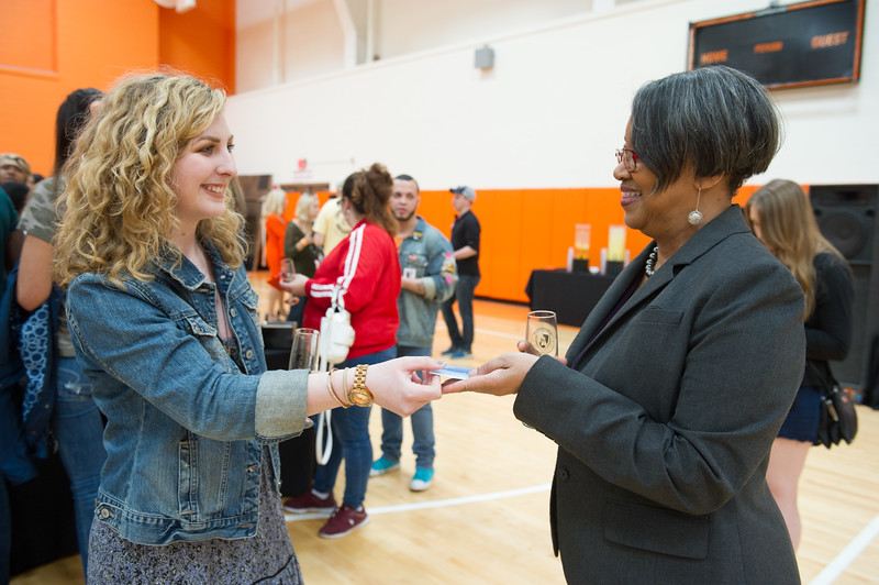 President Katherine Conway-Turner talking with graduating seniors at the Commencement Preview at Buffalo State College.