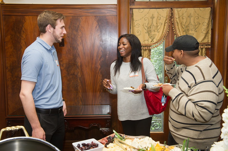 Graduating student reception at President's House at Buffalo State College.