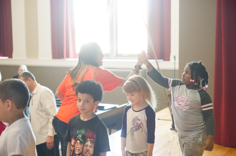 """Buffalo State Anne Frank Project students performing """"Level Up"""" show for students at Roosevelt Elementary School."""
