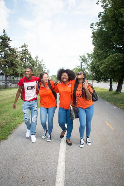 Buffalo State College students walking through Elmwood Village.