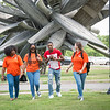 Buffalo State College students walking on Albright-Knox Art Gallery grounds.