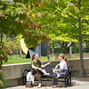 Campus scenic with students talking on bench at Buffalo State College.