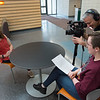 Marketing and Communications video team interviewing student at Buffalo State College.