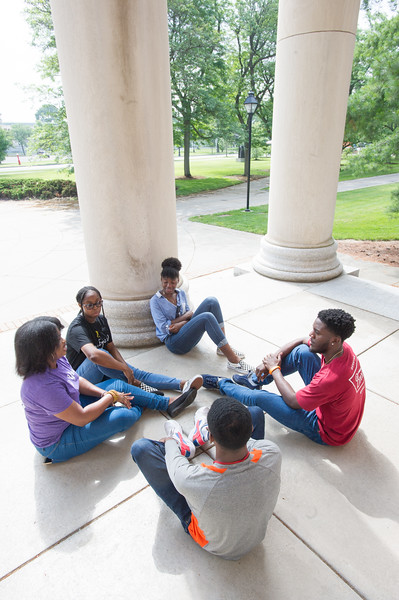 Students talking on Rockwell Hall steps at Buffalo State College.