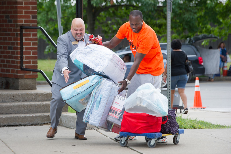 Vice President for Affairs, Timothy Gordon speaking with students and parents during Move In Day at Buffalo State College.