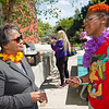 President Katherine Conway-Turner talking with student during the Career Development Center Part-time Job Fair Luau at Buffalo State College.