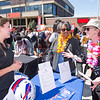 President Katherine Conway-Turner talking with employers during the Career Development Center Part-time Job Fair Luau at Buffalo State College.