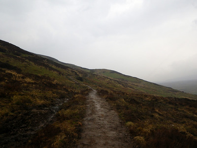 Climbing Conic Hill - a muddy and windy affair!