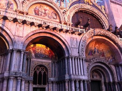 Setting sun over the entrance of St. Mark's Basilica