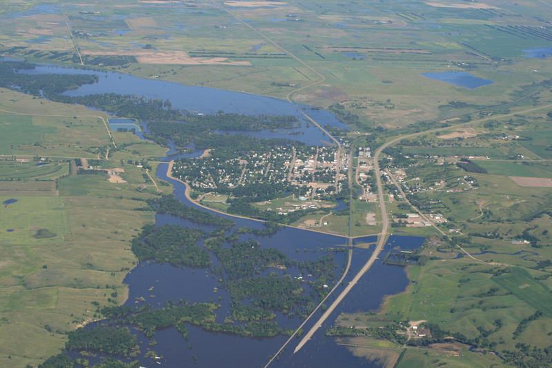 The town of Velva, ND, saved by a quickly constructed dike.  The rest of the river valley is flooded.