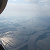 May 10, after dodging thunderstorms around St. Louis, approaching Cairo Illinois.  Flooding Mississippi River meandering across the foreground.  Looking Southeast, with the Ohio River just visible, coming in from upper left.