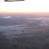 Wispy fog, farms, and Lake Okoboji upper left.