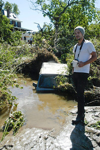 ERIC FRANCIS PHOTO Corey Hathorn of Quechee left his Jeep in a parking lot downtown figuring he could use it to drive to higher ground if the rains got too heavy.   He finally found it Monday down behind the Parker House.