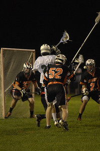 Hunter Schmell shoots on the Middlebury Tigers goal