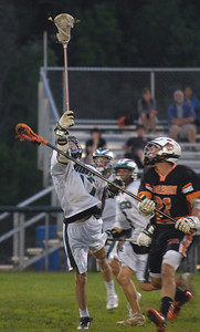 #17 Alex Melville jumps for the ball