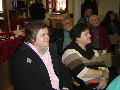 Two sisters, Mary Jo and Kathy Castellini, with John and Joan Keramis in background