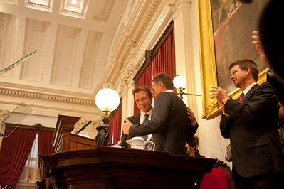 Lieutenant Governor Phil Scott listens to Governor-elect Peter Shumlin just before Shumlin's swearing in at the Vermont State House Thursday, 6 January 2011. (Herald / Tim Calabro)