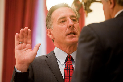 Governor Peter Shumlin administers the oath of officer to Secretary of State Tom Salmon Thursday, 6 January 2011. (Herald / Tim Calabro)
