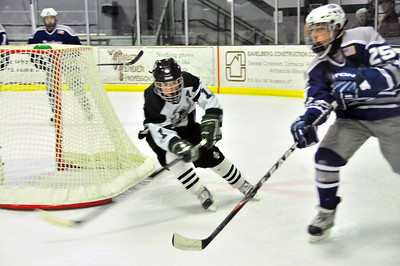 The WUHS Boys Hockey team played a strong game Monday but eventually bowed to U-32, 5-2. Nick Schmell chases down the puck. Tim Gould Photos