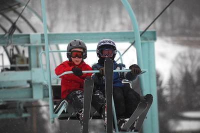 Kids ride the ski lift