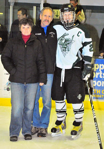 Senior Brian Martin stands with mom Julie Martin and John Kuhn.  Tim Gould photo.