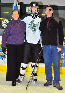 Senior Adam Birmingham poses with parents Bill and Sheila. Tim Gould photo.