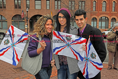 Chris Richie | Staff Left to right, Edessa Pireh, Rafael Moochi and D'Anna France at the Assyrian flag raising ceremony celebrating the Assyrian new year 6761 at New Britain's Central Park. (4/1/11)