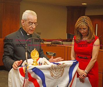 Chris Richie | Staff Core Bishop Aaron George gives a blessing next to Agnes Pireh, eastern regional director, with AANF (Assyrian American National Federation)  before the Assyrian flag raising ceremony celebrating the Assyrian new year 6761 at New Britain City Hall. (4/1/11)