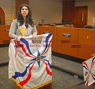 Chris Richie | Staff Samara Brakhia, president of St. Thomas Assyrian Church of East in New Britain, explains the meaning of the Assyrian flag before the flag raising ceremony celebrating the Assyrian new year 6761 at New Britain City Hall. (4/1/11)