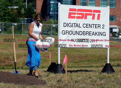 8/2/2011 Mike Orazzi | Staff ESPN's Aneidy Girotti arranges shovels and hard hats during a ground breaking for ESPN's new digital center at 1 ESPN Drive, Bristol on Tuesday afternoon.