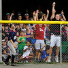 8/14/2010 Mike Orazzi | Staff<br /> Rhode Island's Nate Paine (9) reaches the fence as a fan catches the home run ball hit by Connecticut's Tommy Ryan (24)  during a 1-0 win over Rhode Island in the New England Final during the 2010 Eastern Regional Little League Tournament in Bristol, Conn., on Saturday, August 14, 2010.