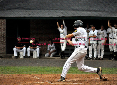 7/25/11 Kayla Adams Unionville's David Kerlezja (9) swings at a pitch from Bristol during the Legion Baseball Tournament at Muzzy Field in Bristol Monday evening.