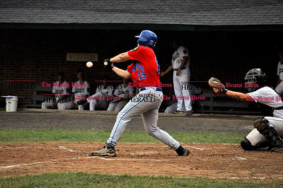 7/25/11 Kayla Adams Bristol's Austin Howard (15) hits a pitch from Unionville's David Weigard during the Legion Baseball Tournament at Muzzy Field in Bristol Monday evening.