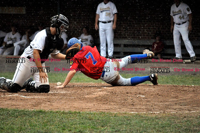 7/25/11 Kayla Adams Bristol's Kyle Dube (7) safely slides into home plate during the Legion Baseball Tournament against Unionville at Muzzy Field in Bristol Monday evening.