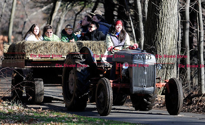12/3/2011 Mike Orazzi | Staff Jaime Ryskowski drives a hayride at the Indian Rock Nature Center during Santa's petting farm on Saturday in Bristol.