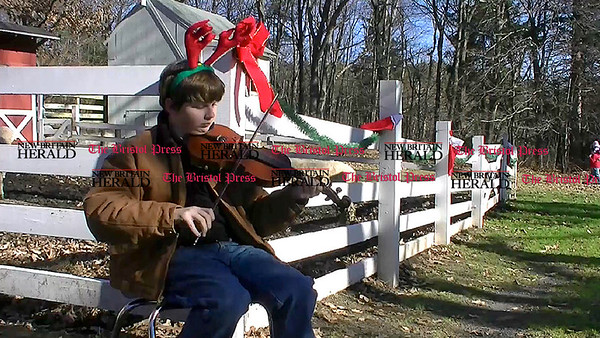 12/3/2011 Mike Orazzi | Staff Tom Vaughn while playing Christmas music on a violin at the Indian Rock Nature Center during Santa's petting farm on Saturday in Bristol.