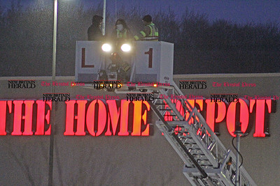 Samantha Burr Firemen check out The Home Depot's roof Tuesday night in Southington. (2/1/11)